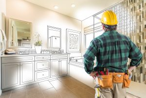 a man planning a bathroom cabinet refacing project